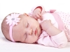 baby in pink with headband